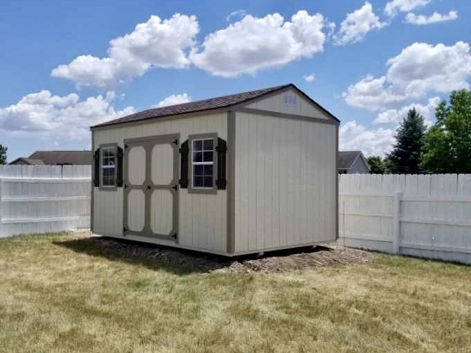 Amish Garden Shed with Shutters and two windows in backyard in Adrian, Michigan