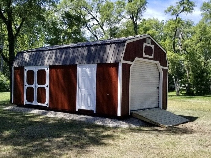 Red Amish Lofted Garage with double doors and side door for access