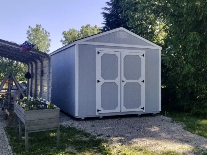 Amish Utility Shed next to carport on customer property