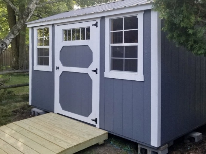 Amish Storage Garden Shed with ramp and transom window near trees