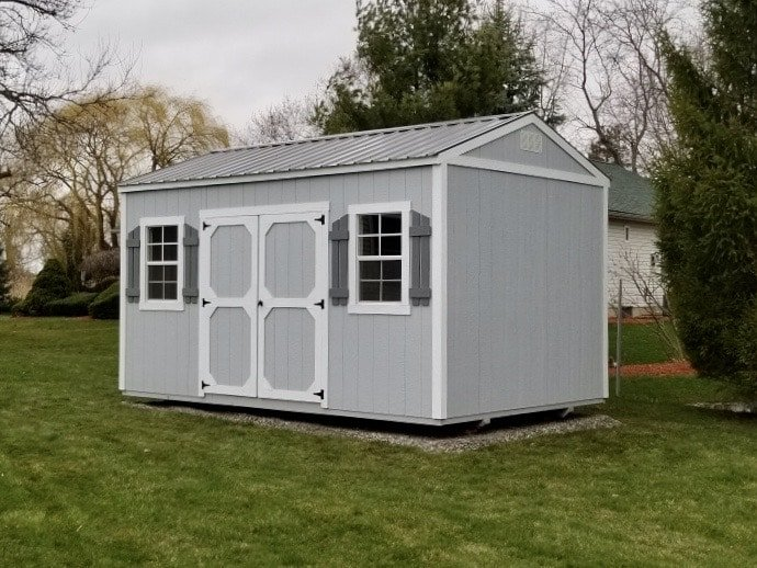 Amish Garden Shed with Shutters in backyard for a customer of Amish Outdoor Buildings