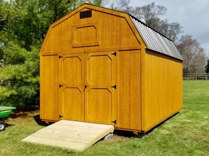 Honeygold Amish Lofted Barn with Ramp in backyard after delivery