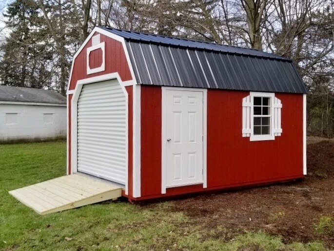 Red Amish Storage Garage with Side Door and Shutters